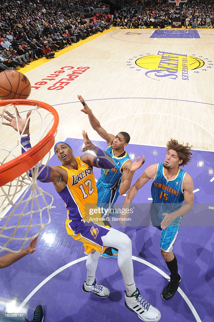 Dwight Howard #12 of the Los Angeles Lakers goes up for a shot against Anthony Davis #23 and Robin Lopez #15 of the New Orleans Hornets at Staples Center on January 29, 2013 in Los Angeles, California.