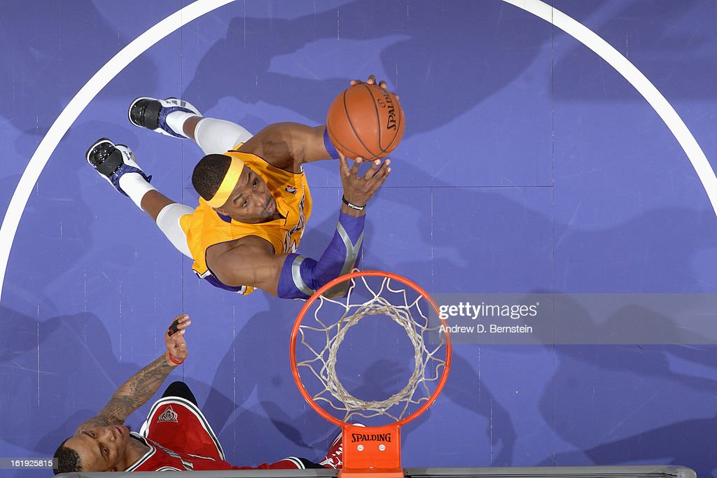 Dwight Howard #12 of the Los Angeles Lakers goes up for the slamdunk at Staples Center on January 15, 2013 in Los Angeles, California.