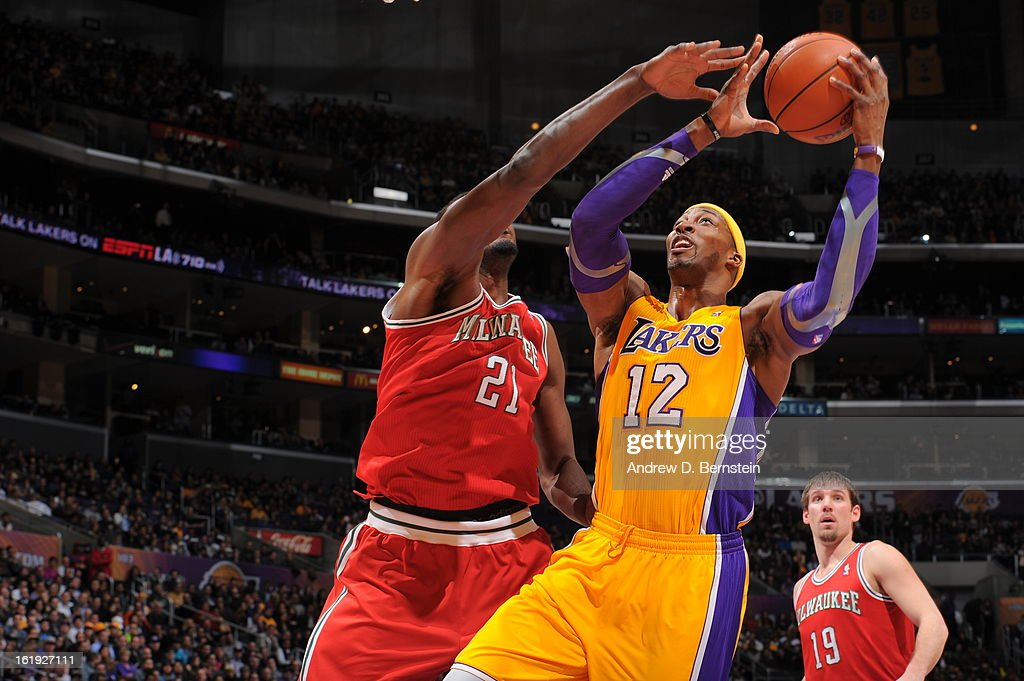 Dwight Howard #12 of the Los Angeles Lakers goes up strong to the basket against the Milwaukee Bucks at Staples Center on January 15, 2013 in Los Angeles, California.