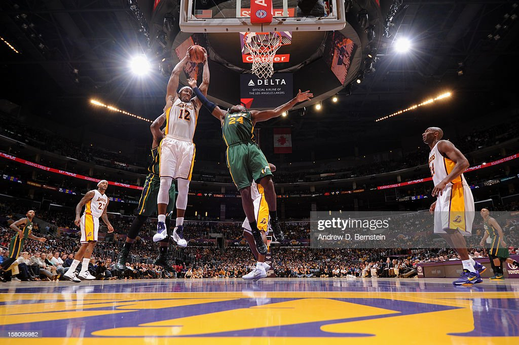Dwight Howard #12 of the Los Angeles Lakers grabs the rebound against Paul Millsap #24 of the Utah Jazz at Staples Center on December 9, 2012 in Los Angeles, California.
