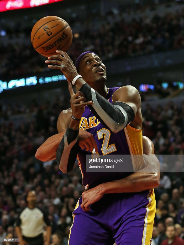 Dwight Howard #12 of the Los Angeles Lakers looses the ball after being wrapped up by Joakim Noah #13 of the Chicago Bulls at the United Center on January 21, 2013 in Chicago, Illinois.