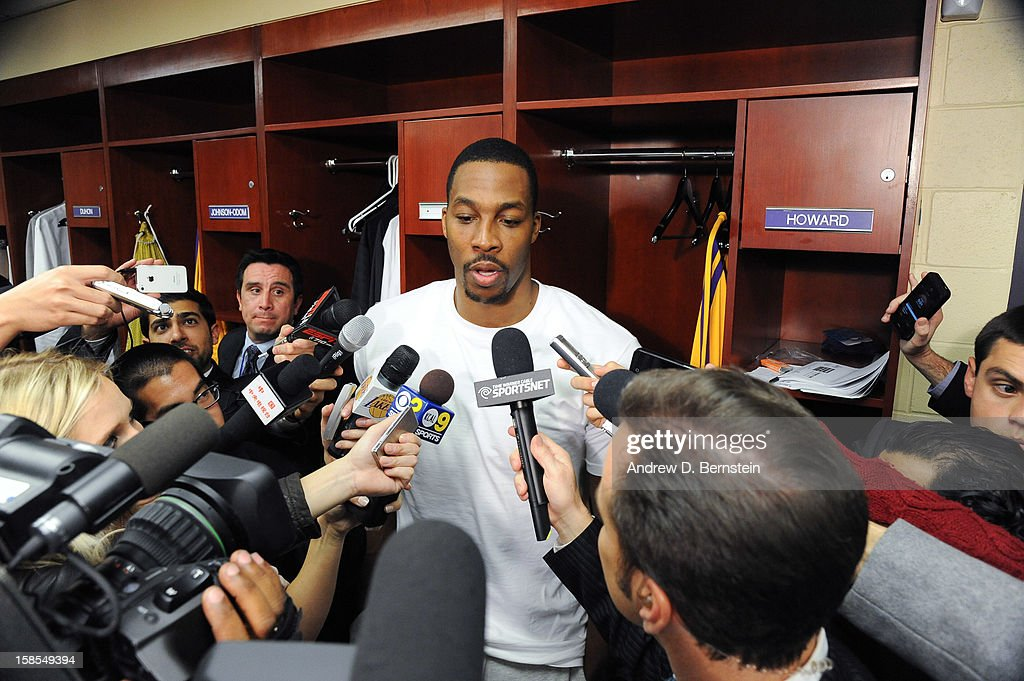 Dwight Howard #12 of the Los Angeles Lakers of the Los Angeles Lakers answers questions from the media following his team's victory against the Charlotte Bobcats at Staples Center on December 18, 2012 in Los Angeles, California.