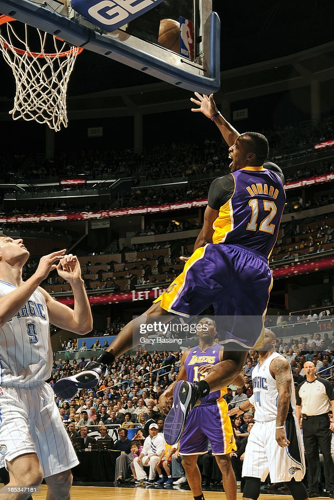 Dwight Howard #12 of the Los Angeles Lakers puts up a shot against the Orlando Magic on March 12, 2013 at Amway Center in Orlando, Florida.