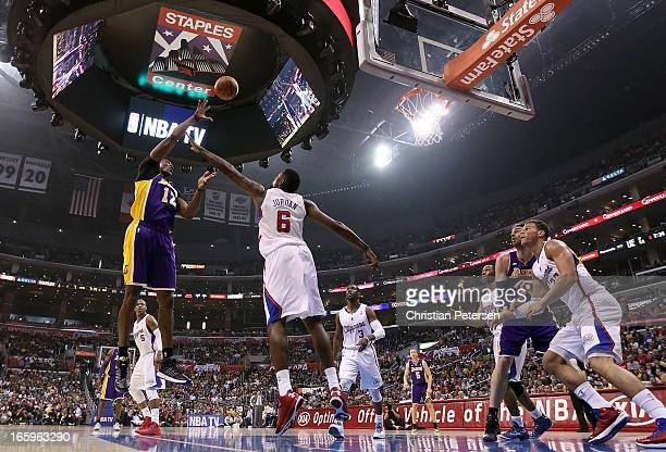 Dwight Howard of the Los Angeles Lakers puts up a shot over DeAndre Jordan of the Los Angeles Clippers during the first half of the NBA game at...