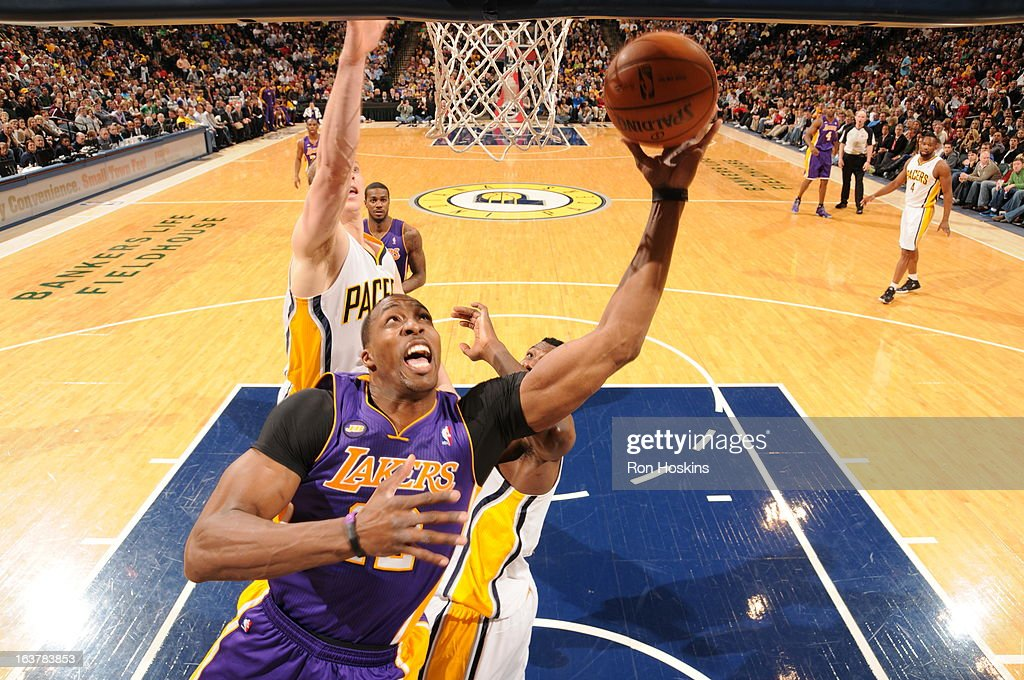 Dwight Howard #12 of the Los Angeles Lakers shoots a layup against the Indiana Pacers on March 15, 2013 at Bankers Life Fieldhouse in Indianapolis, Indiana.