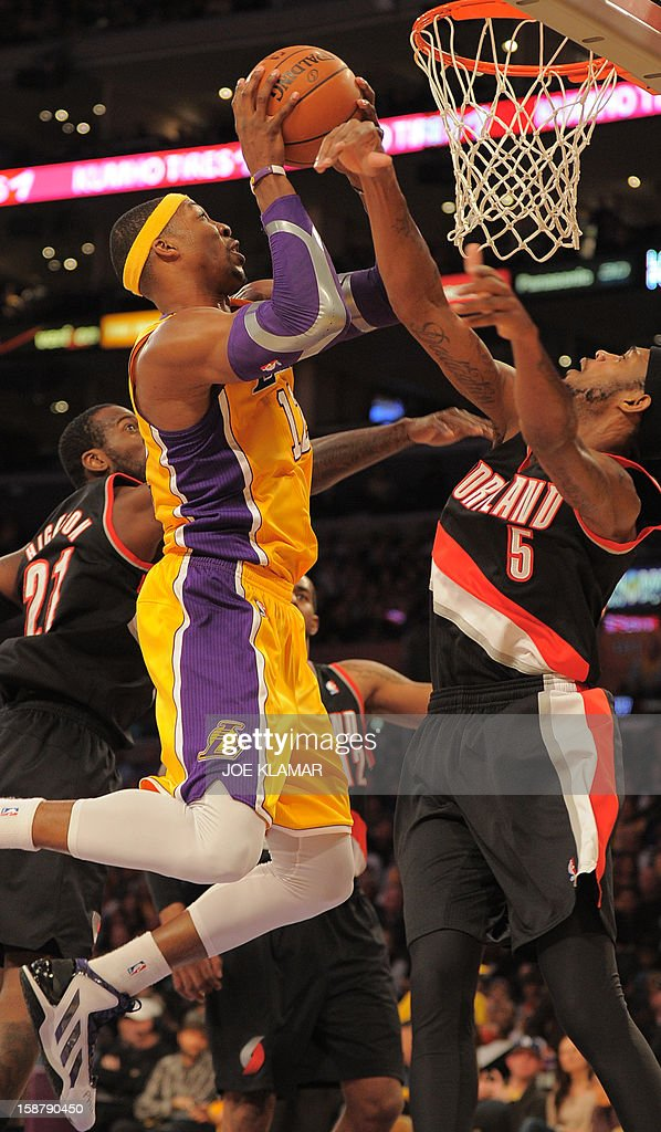 Dwight Howard (L) of the Los Angeles Lakers shoots against (R) Will Barton of the Portland Trail Blazers during their NBA game on December 28, 2012 at Staples Center in Los Angeles, California. The Lakers rolled over the Blazers 104-87. AFP PHOTO / Joe KLAMAR