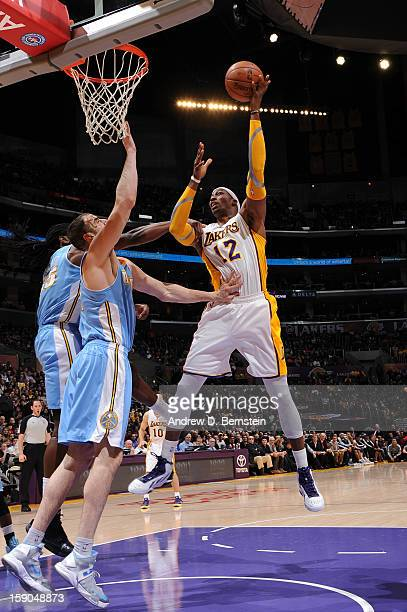 Dwight Howard of the Los Angeles Lakers shoots in the lane against Kosta Koufos of the Denver Nuggets at Staples Center on January 6 2013 in Los...