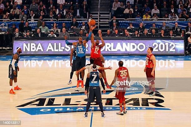 Dwight Howard of the Orlando Magic and the Eastern Conference fights for the opening tipoff against Andrew Bynum of the Los Angeles Lakers and the...