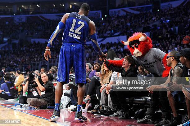 Dwight Howard of the Orlando Magic and the Eastern Conference singer Justin Bieber and Chicago Bulls mascot 'Benny the Bull' courtside during the...