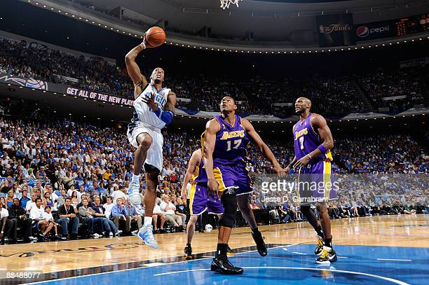 Dwight Howard of the Orlando Magic attempts a shot against Andrew Bynum of the Los Angeles Lakers in Game Five of the 2009 NBA Finals at Amway Arena...