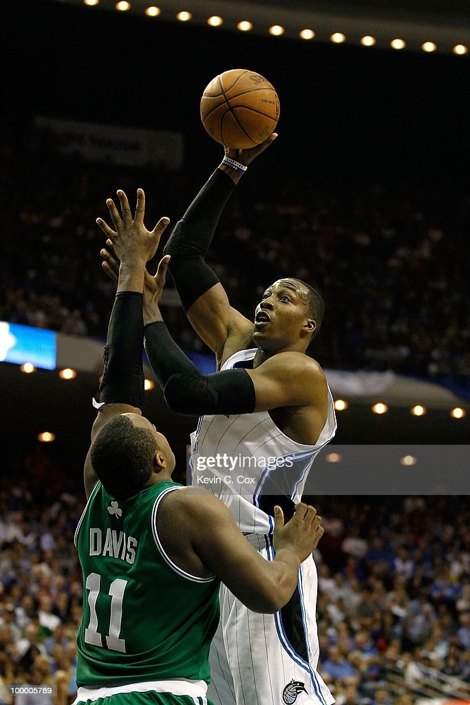 Dwight Howard #12 of the Orlando Magic attempts a shot against Glen Davis #11 of the Boston Celtics in Game Two of the Eastern Conference Finals during the 2010 NBA Playoffs at Amway Arena on May 18, 2010 in Orlando, Florida.