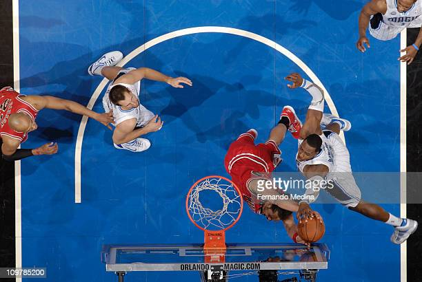 Dwight Howard of the Orlando Magic blocks the shot of Joakim Noah of the Chicago Bulls on March 4 2011 at the Amway Center in Orlando Florida NOTE TO...