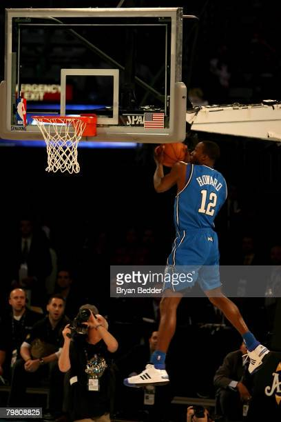 Dwight Howard of the Orlando Magic bounces the ball off the back of the backboard for his dunk in the first round of the Sprite Slam Dunk Contest...