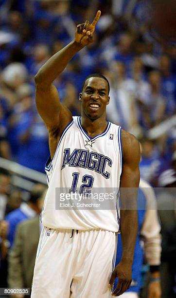 Dwight Howard of the Orlando Magic celebrates their 10292 win against the Toronto Raptors in Game Five of the Eastern Conference Quarterfinals during...