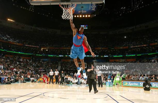 Dwight Howard of the Orlando Magic completes his SUperman dunk during the Sprite Slam Dunk Contest part of 2008 NBA AllStar Weekend at the New...