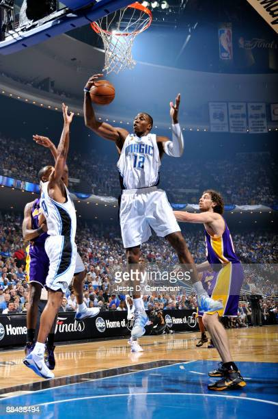 Dwight Howard of the Orlando Magic controls a rebound against the Los Angeles Lakers in Game Four of the 2009 NBA Finals at Amway Arena on June 11...