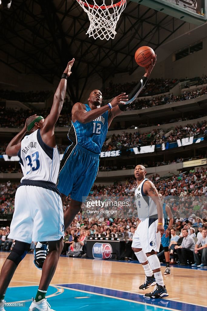 Dwight Howard #12 of the Orlando Magic drives to the basket against Brendan Haywood #33 and Caron Butler #4 of the Dallas Mavericks on April 1, 2010 at American Airlines Center in Dallas, Texas. The Magic won 97-82.