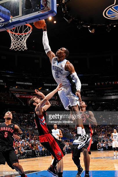 Dwight Howard of the Orlando Magic dunks against Ed Davis and Jose Calderon of the Toronto Raptors on January 21 2011 at the Amway Center in Orlando...
