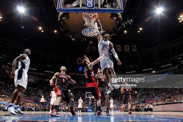 Dwight Howard of the Orlando Magic dunks against Jose Calderon of the Toronto Raptors on January 21 2011 at the Amway Center in Orlando Florida NOTE...