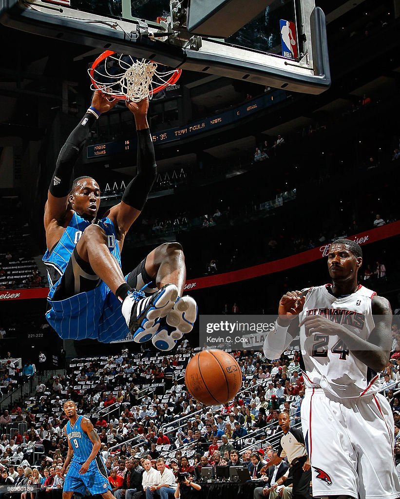Dwight Howard #12 of the Orlando Magic dunks against Marvin Williams #24 of the Atlanta Hawks during Game Four of the Eastern Conference Semifinals of the 2010 NBA Playoffs at Philips Arena on May 10, 2010 in Atlanta, Georgia.