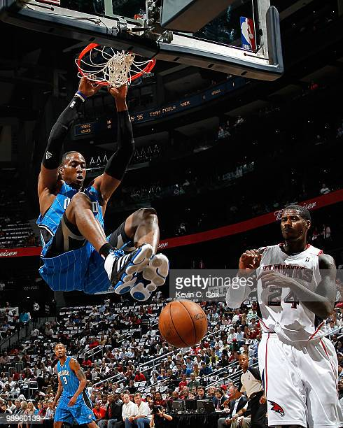 Dwight Howard of the Orlando Magic dunks against Marvin Williams of the Atlanta Hawks during Game Four of the Eastern Conference Semifinals of the...