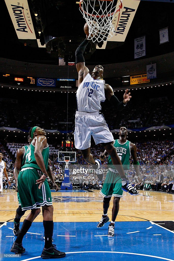 Dwight Howard #12 of the Orlando Magic dunks against Paul Pierce #34 and Kevin Garnett #5 of the Boston Celtics in Game Five of the Eastern Conference Finals during the 2010 NBA Playoffs at Amway Arena on May 26, 2010 in Orlando, Florida.