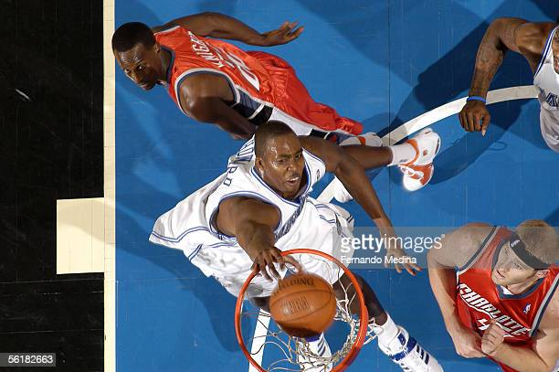 Dwight Howard of the Orlando Magic dunks against the Charlotte Bobcats on November 15 2005 at TD Waterhouse Centre in Orlando Florida The Magic...