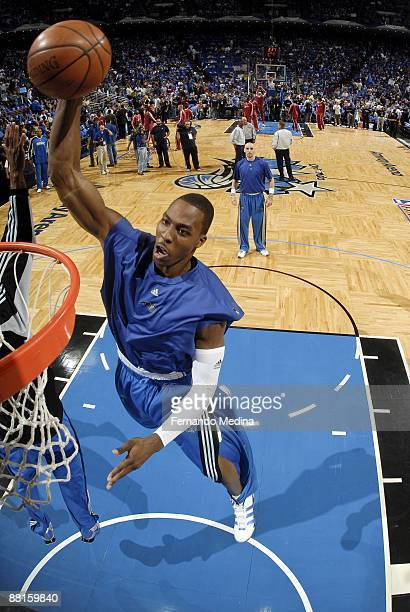 Dwight Howard of the Orlando Magic dunks during warm ups before the game against the Cleveland Cavaliers in Game Six of the Eastern Conference Finals...