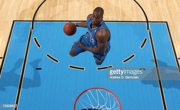 Dwight Howard of the Orlando Magic dunks in the first round of the Sprite Slam Dunk Competition at NBA All-Star Weekend at the Thomas & Mack Center...