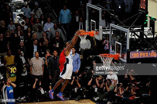 Dwight Howard of the Orlando Magic dunks on a 12foot hoop during the Sprite Slam Dunk Contest on AllStar Saturday Night part of 2009 NBA AllStar...