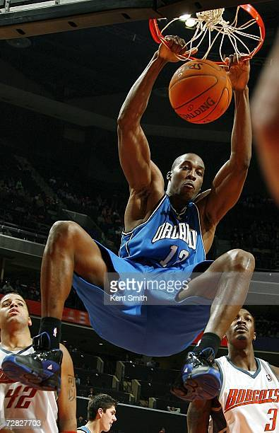 Dwight Howard of the Orlando Magic dunks over the Charlotte Bobcats on December 14 2006 at the Charlotte Bobcats Arena in Charlotte North Carolina...
