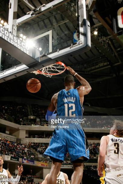 Dwight Howard of the Orlando Magic dunks over Troy Murphy of the Indiana Pacers at Conseco Fieldhouse on February 6, 2009 in Indianapolis, Indiana....