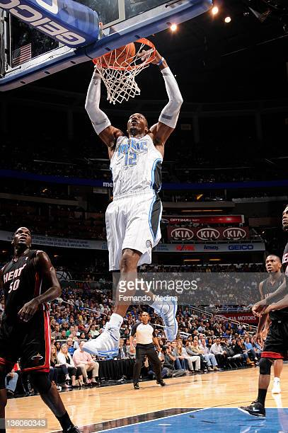Dwight Howard of the Orlando Magic dunks the basketball against the Miami Heat during the preseason game on December 21 2011 at Amway Center in...