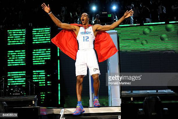Dwight Howard of the Orlando Magic emerges from a phone booth wearing a Superman cape during the Sprite Slam Dunk Contest on AllStar Saturday Night...