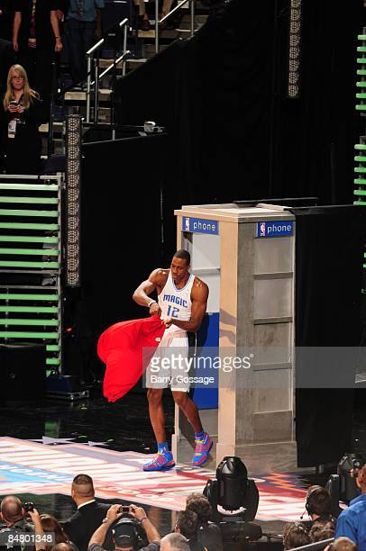 Dwight Howard of the Orlando Magic exits a telephone booth wearing a superman cape during the Sprite Slam Dunk Contest as part of 2009 NBA AllStar...