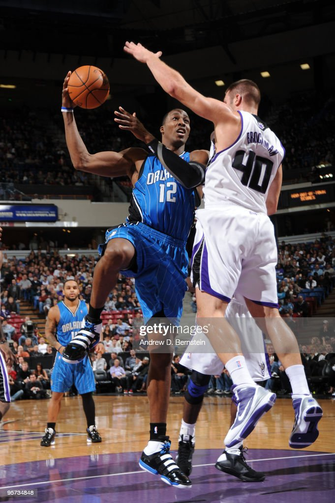 Dwight Howard #12 of the Orlando Magic goes up for the shot against Jon Brockman #40 of the Sacramento Kings on January 12, 2010 at Arco Arena in Sacramento, California.