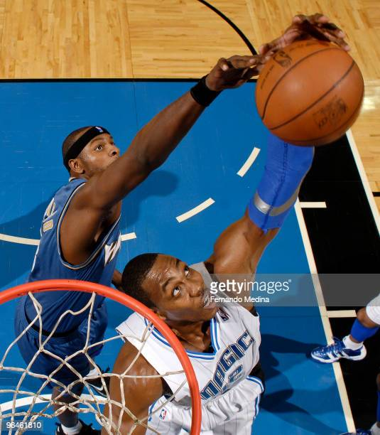 Dwight Howard of the Orlando Magic grabs a rebound against Brendan Haywood of the Washington Wizards during the game on February 5 2010 at Amway...
