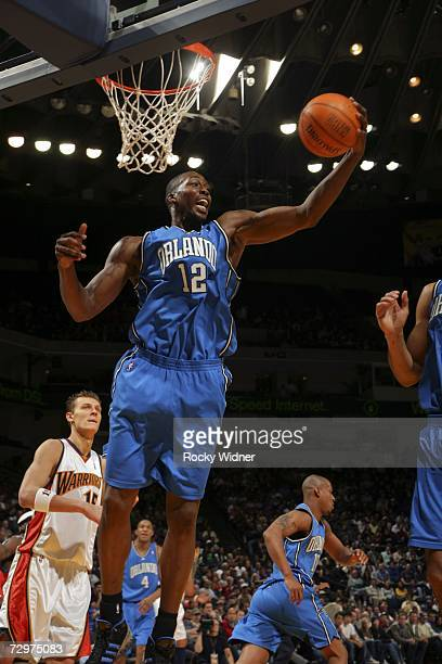 Dwight Howard of the Orlando Magic grabs a rebound against the Golden State Warriors on January 10 2007 at Oracle Arena in Oakland California NOTE TO...
