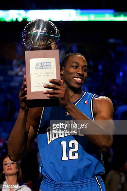 Dwight Howard of the Orlando Magic holds up the championship trophy after winning the Sprite Slam Dunk Contest part of 2008 NBA AllStar Weekend at...