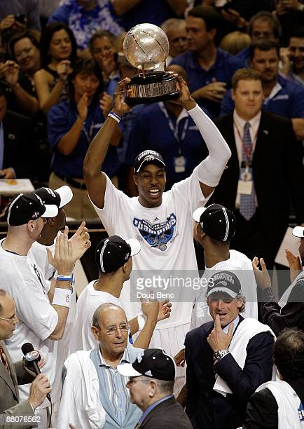 Dwight Howard of the Orlando Magic holds up the trophy after defeating the Cleveland Cavaliers in Game Six of the Eastern Conference Finals during...