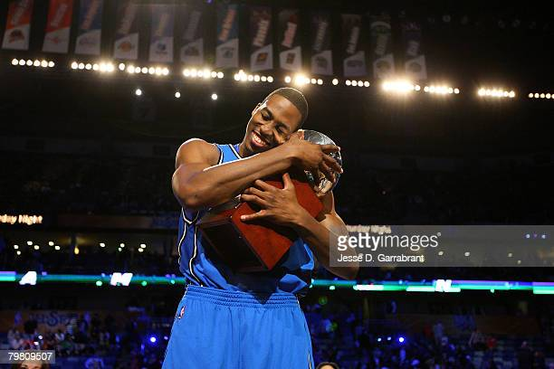 Dwight Howard of the Orlando Magic hugs his trophy after winning the Sprite Slam Dunk Contest part of 2008 NBA AllStar Weekend at the New Orleans...