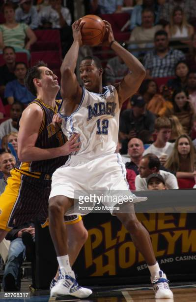 Dwight Howard of the Orlando Magic is defended by Austin Croshere of the Indiana Pacers during a game at TD Waterhouse Centre on April 18 2005 in...