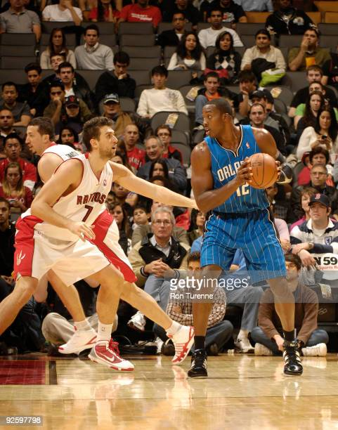 Dwight Howard of the Orlando Magic looks to back down defender Andrea Bargnani of the Toronto Raptors during a game on November 1 2009 at the Air...