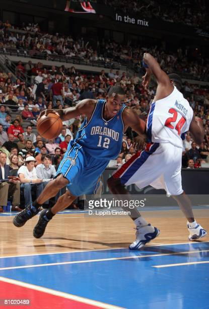 Dwight Howard of the Orlando Magic makes a move to the basket against Antonio McDyess of the Detroit Pistons in Game Two of the Eastern Conference...
