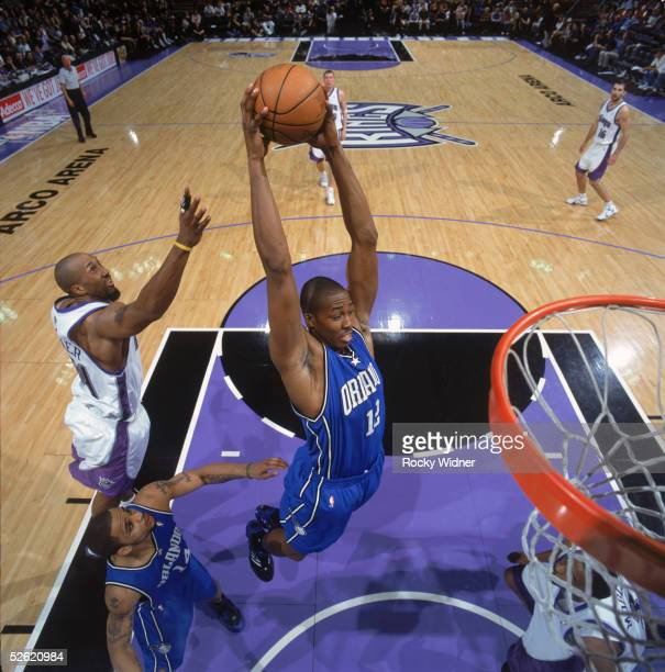 Dwight Howard of the Orlando Magic makes a rebound against the Sacramento Kings at Arco Arena on March 15 2005 in Sacramento California The Kings won...