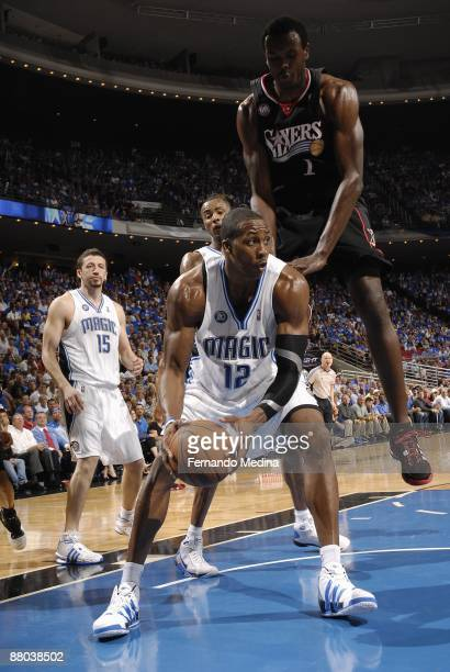 Dwight Howard of the Orlando Magic moves the ball against Samuel Dalembert of the Philadelphia 76ers in Game Five of the Eastern Conference...