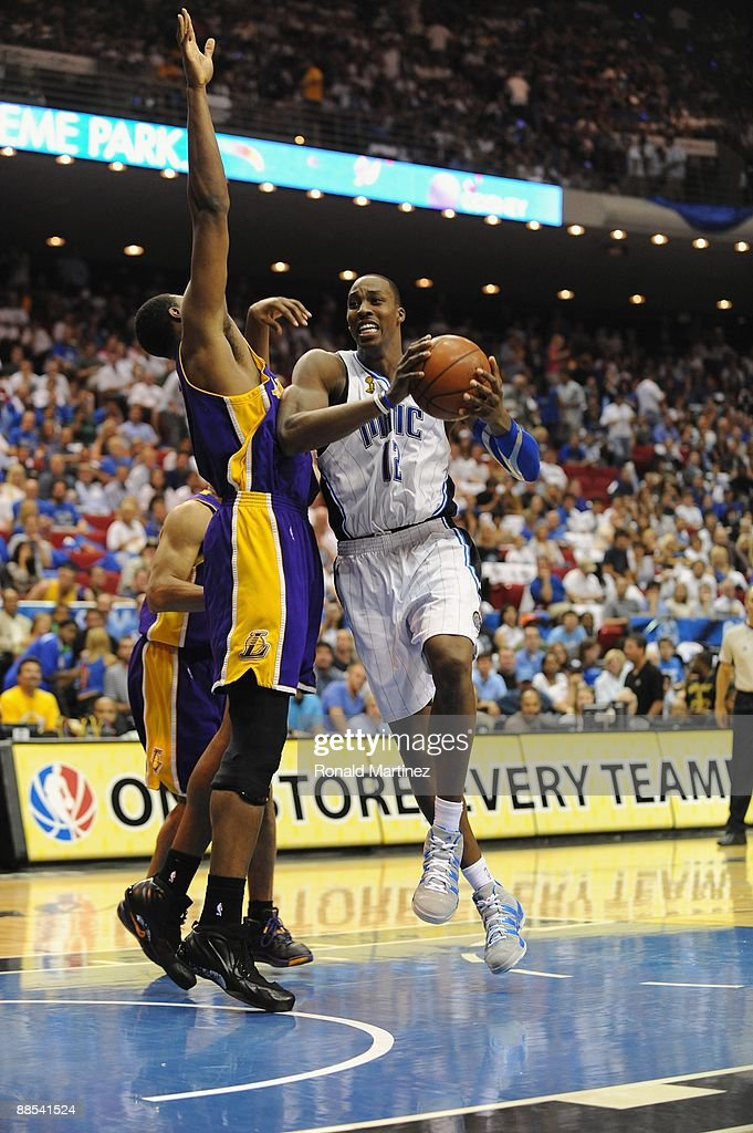 Dwight Howard #12 of the Orlando Magic moves through the lane against Andrew Bynum #17 of the Los Angeles Lakers in Game Five of the 2009 NBA Finals on June 14, 2009 at Amway Arena in Orlando, Florida. The Lakers won 99-86.