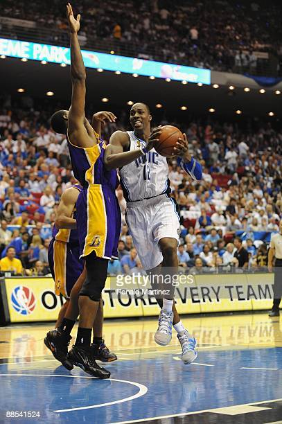 Dwight Howard of the Orlando Magic moves through the lane against Andrew Bynum of the Los Angeles Lakers in Game Five of the 2009 NBA Finals on June...