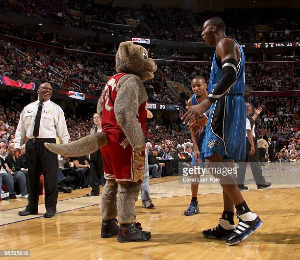 Dwight Howard of the Orlando Magic playfully jaws with Cleveland Cavaliers mascot Moondog during a break in the action on April 11, 2010 at The...