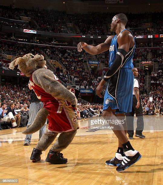 Dwight Howard of the Orlando Magic playfully swats at Cleveland Cavaliers mascot Moondog during a break in the action on April 11, 2010 at The...
